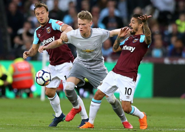 10th May 2018, London Stadium, London, England; EPL Premier League football, West Ham United versus Manchester United; Scott McTominay of Manchester United pushes past Manuel Lanzini and Mark Noble of West Ham United (photo by John Patrick Fletcher/Action Plus via Getty Images)