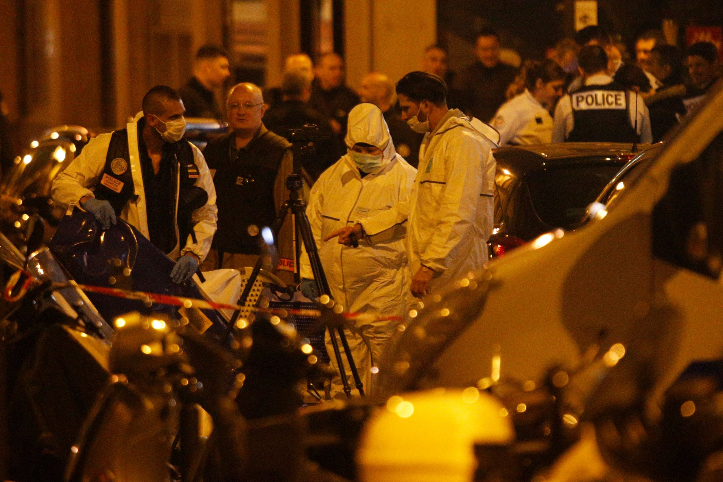 """Forensic officers and French policemen stand in Monsigny street in Paris centre after one person was killed and several injured by a man armed with a knife, who was shot dead by police in Paris on May 12, 2018. - The attack took place near the city's main opera house. Police indicated that the attacker had been """"overcome"""" and his motives are unknown. The man attacked five people with a knife, one of whom died, police said. Two were in serious condition and all the victims are in hospital. (Photo by Geoffroy VAN DER HASSELT / AFP) (Photo credit should read GEOFFROY VAN DER HASSELT/AFP/Getty Images) ***BESTPIX***"""