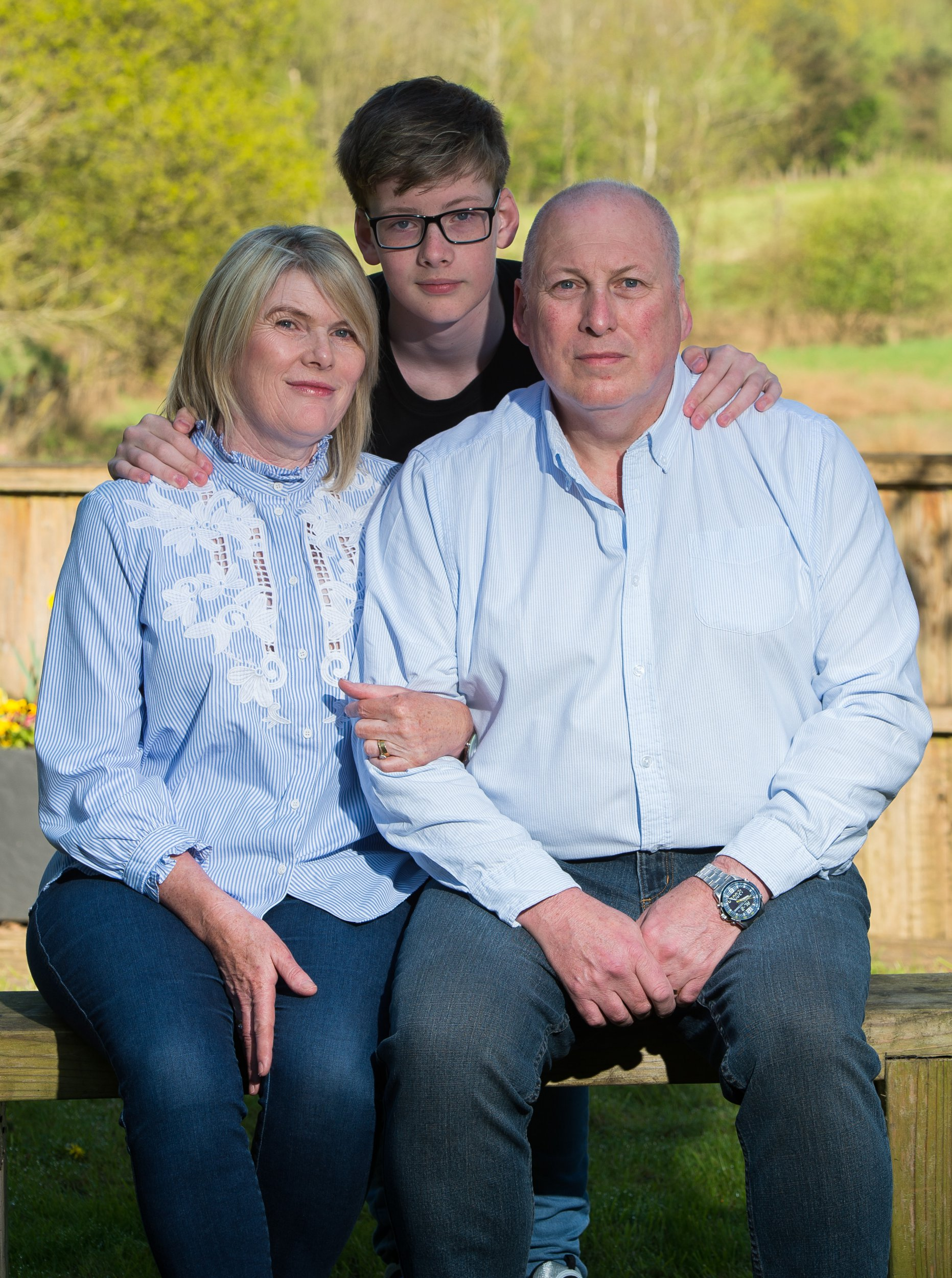 Embargoed until 1pm 13.05.18 - Online usage fee ?150 per photo. Print fee ?300 per photo. A SALESMAN who suffered a brain tumour is suing Nokia for ?significant? compensation which could hit ?1million ? in a case that could cost mobile phone firms a fortune. Father-of-six Neil Whitfield, 60, claims heavy phone use in the late 1990s caused a deadly growth. Neil is pictured with wife Caroline and son Harry.