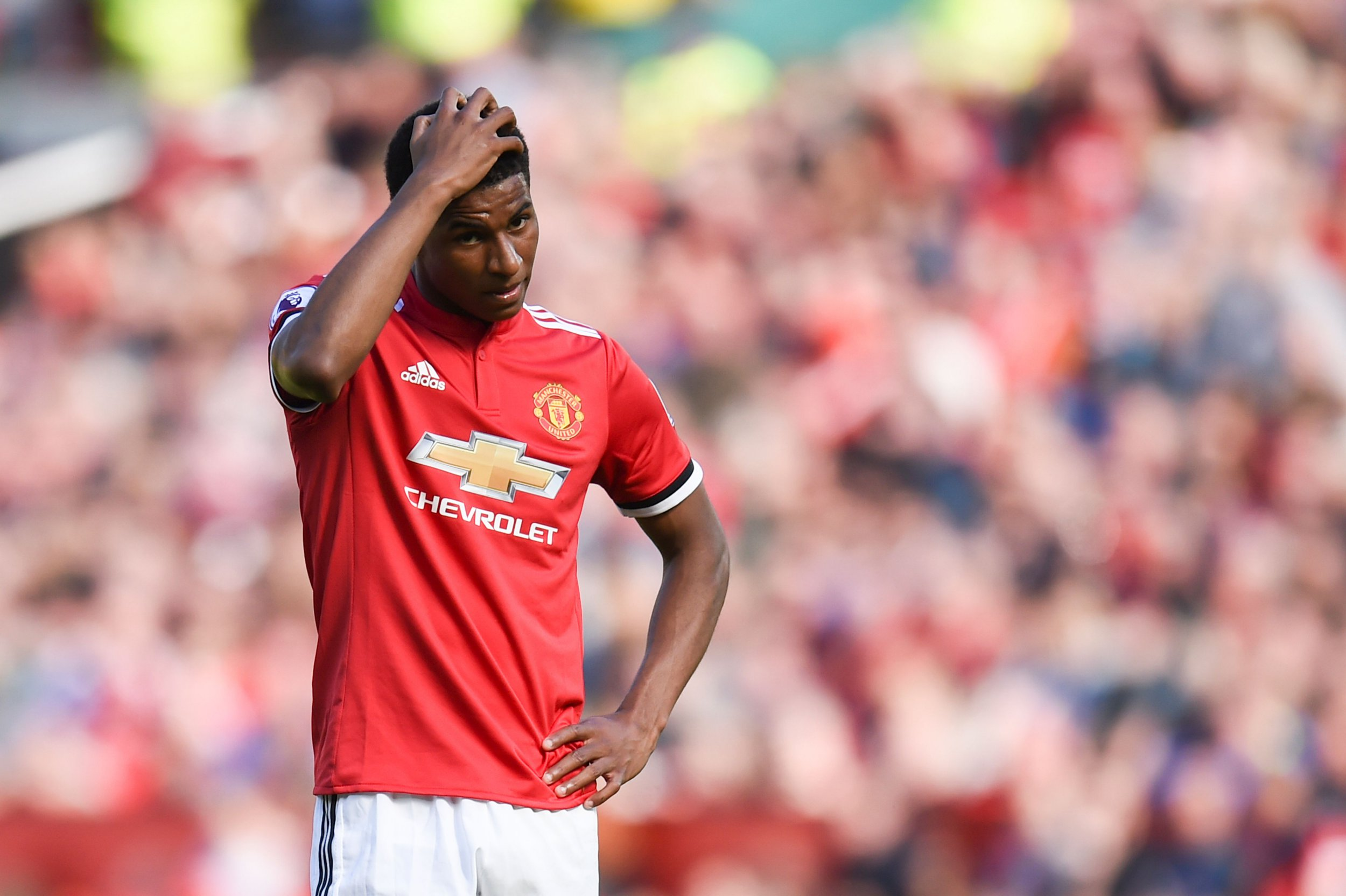 Manchester United's English striker Marcus Rashford reacts after missing a chance during the English Premier League football match between Manchester United and Watford at Old Trafford in Manchester, north west England, on May 13, 2018. / AFP PHOTO / Oli SCARFF / RESTRICTED TO EDITORIAL USE. No use with unauthorized audio, video, data, fixture lists, club/league logos or 'live' services. Online in-match use limited to 75 images, no video emulation. No use in betting, games or single club/league/player publications. / OLI SCARFF/AFP/Getty Images