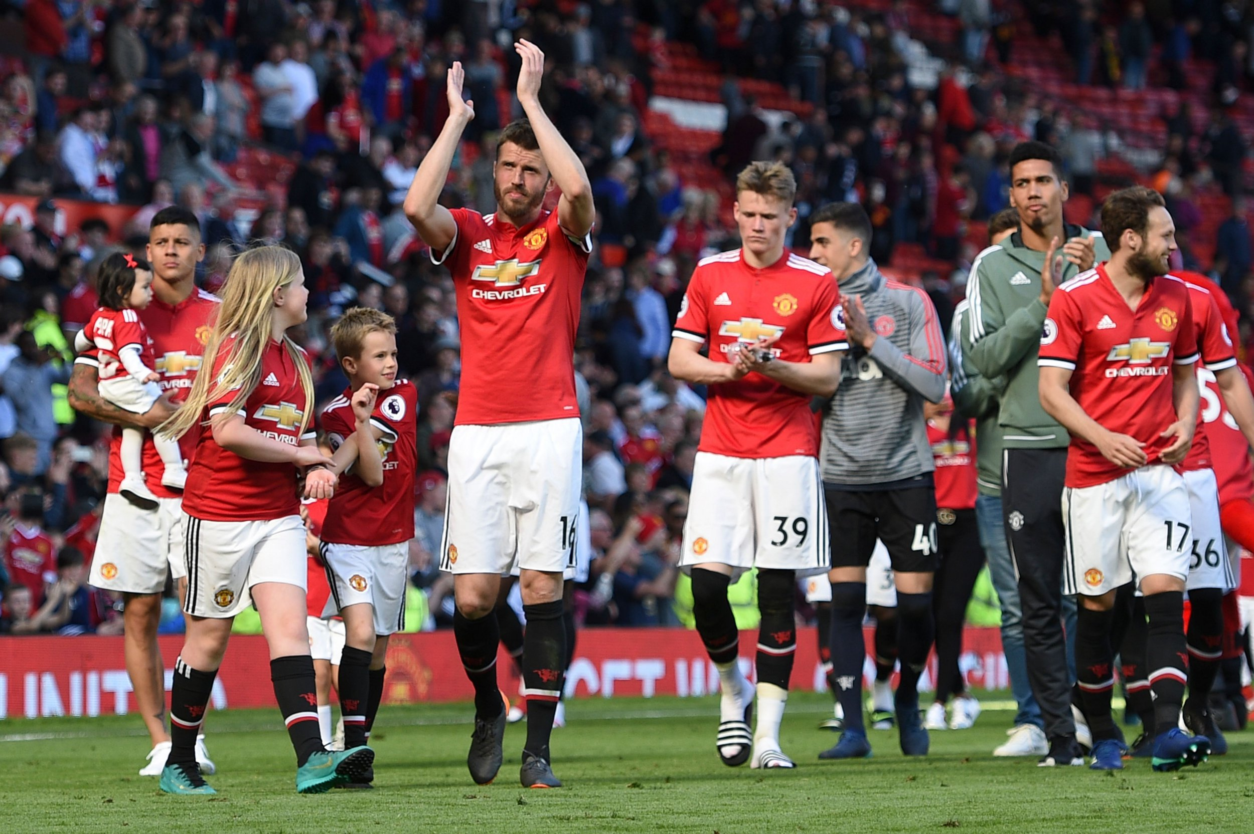 Manchester United's English midfielder Michael Carrick (C) applauds the crowd at the end of the English Premier League football match between Manchester United and Watford at Old Trafford in Manchester, north west England, on May 13, 2018. / AFP PHOTO / Oli SCARFF / RESTRICTED TO EDITORIAL USE. No use with unauthorized audio, video, data, fixture lists, club/league logos or 'live' services. Online in-match use limited to 75 images, no video emulation. No use in betting, games or single club/league/player publications. / OLI SCARFF/AFP/Getty Images
