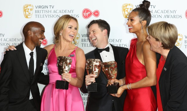 LONDON, ENGLAND - MAY 13: Mo Farah (L) and Clare Balding (R) with (L-R) Amanda Holden (2ndR), Declan Donnelly (C) and Alesha Dixon (3rdR) with the award for Entertainment Programme for 'Britain's Got Talent', pose in the press room at the Virgin TV British Academy Television Awards at The Royal Festival Hall on May 13, 2018 in London, England. (Photo by Tim Whitby/Getty Images)