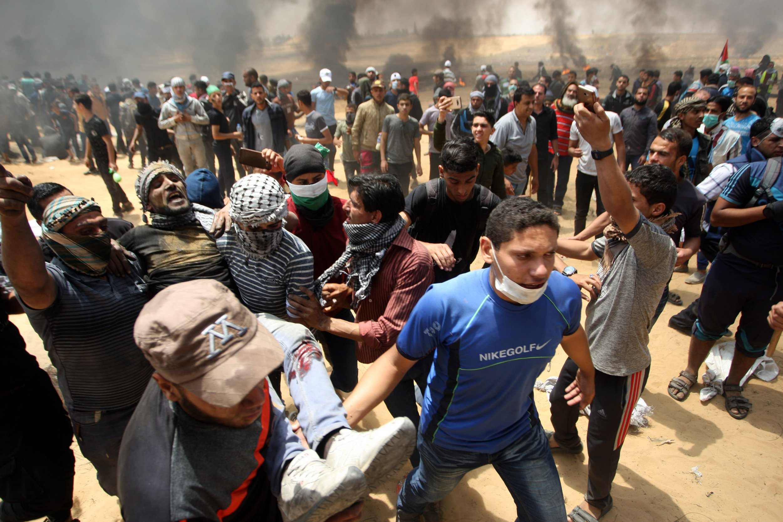 Palestinians carry an injured protestors during demonstration to mark the 70th anniversary of Nakba and against United States' plans today to relocate the U.S. Embassy from Tel Aviv to Jerusalem, near Gaza-Israel border in Rafah southern Gaza on May 14, 2018. More than 40 Palestinians were killed. Nakba refers to the period when Palestinians fled or were driven out of their homes when present-day Israel was formed in 1948. Photo by Ismael Mohamad/UPIPHOTOGRAPH BY UPI / Barcroft Images