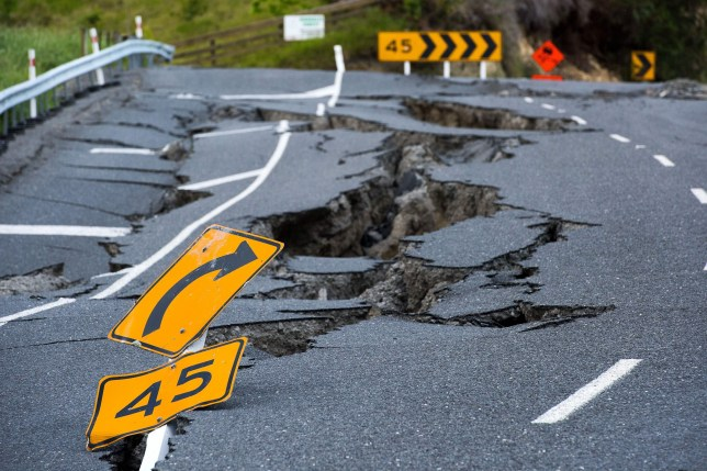 TOPSHOT - Earthquake damage to State Highway 1 is seen south of Kaikoura on November 16, 2016. Rescue efforts after a devastating earthquake in New Zealand intensified on November 16 as a fleet of international warships began arriving in the disaster zone. / AFP / Marty MELVILLE (Photo credit should read MARTY MELVILLE/AFP/Getty Images)
