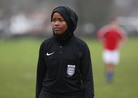 *** EXCLUSIVE - VIDEO AVAILABLE *** WEMBLEY, UNITED KINGDOM - FEBRUARY 2018: JJ refereeing an all male 11-a-side football match in Wembley, England. CONDITION OF USAGE: The following must be included in print and/or online: JJ?s story will feature in The History of Football global TV event, airing on History (excluding USA, Canada, Australia, New Zealand), from May 28th-10th June 2018. AS her first full season as a Football Association-registered official draws to a close, Jawahir Roble has made history as the first Muslim female referee in the UK. Having always loved football, JJ made the decision to pursue refereeing more seriously after studying for coaching badges as a teenager. A local girl?s league was short of match officials and JJ stepped in, eventually going on to do a refereeing course. JJ?s love of the beautiful game goes back to her childhood. Among the rubble of the Mogadishu streets, JJ would play football with her friends and siblings. Pleading with her parents to stay out beyond their curfew so she could play football for longer, JJ wasn?t so much oblivious to the dangers of war as conditioned to it. JJ?s incredible story will feature in The History of Football global TV event, airing on History (excluding USA, Canada, Australia, New Zealand), from May 28th-10th June 2018. PHOTOGRAPH BY Barcroft Images / HISTORY?