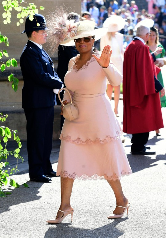 Oprah Winfrey waves as she arrives at St George's Chapel at Windsor Castle the wedding ceremony of Prince Harry and Meghan Markle at St. George's Chapel in Windsor Castle in Windsor, near London, England, Saturday, May 19, 2018. (Ian West/pool photo via AP)
