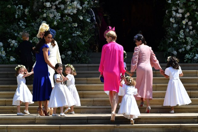 Britain's Catherine, Duchess of Cambridge (L) and Meghan Markle's friend, Canadian fashion stylist Jessica Mulroney (2L) holds bridesmaids hands as they arrive for the wedding ceremony of Britain's Prince Harry, Duke of Sussex and US actress Meghan Markle at St George's Chapel, Windsor Castle, in Windsor, on May 19, 2018. / AFP PHOTO / POOL / Ben STANSALLBEN STANSALL/AFP/Getty Images
