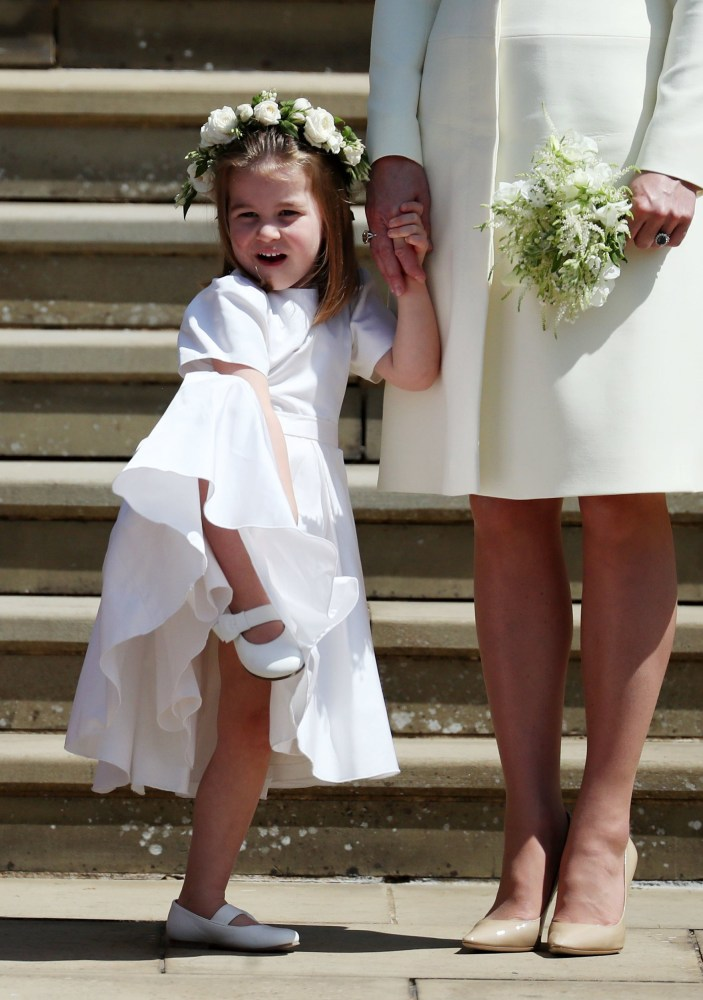 Princess Charlotte on the steps of St George's Chapel in Windsor Castle after the wedding of Prince Harry and Meghan Markle. PRESS ASSOCIATION Photo. Picture date: Saturday May 19, 2018. See PA story ROYAL Wedding. Photo credit should read: Jane Barlow/PA Wire