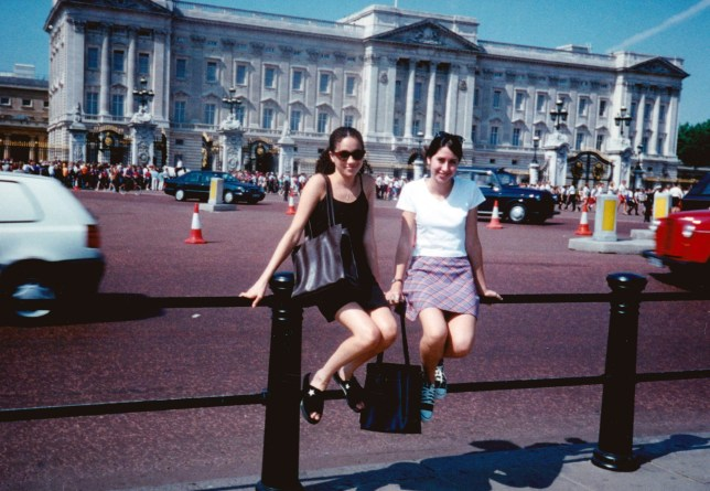 """EXCLUSIVE: **PREMIUM EXCLUSIVE * FEE MUST BE AGREED BEFORE EVERY USE* Playfully posing outside Buckingham Palace, as millions of foreign tourists have done over the years, little could she have known she would be entering its gates - and the most exclusive of clubs - 21 years later. The remarkable image, taken during a European summer trip in 1996, has emerged as the world awaits the royal wedding of the year. It is part of a revealing collection of photos showing the future princess as a normal girl, growing up from a toddler until her early 20s, shared by her former best friend and maid of honour Ninaki Priddy. Ninaki and 'Meg' first met aged 2 at a prestigious kindergarten - Little Red House School - in the famous Los Angeles neighbourhood of Hollywood and became immediately inseparable. The photos show them together at events in primary school and high school, including proms; spending time at each other's houses; meeting famous actors as children; partying in their home town of Los Angeles and in Chicago, where Meghan went to college. Meghan even joined Ninaki's family on a summer trip to Europe in 1996 - where she made sure they visited Buckingham Palace. """"You can see her posing - she is loving it! It's as if that was her place, she was ready for it."""" Another prescient photo from that trip shows Meghan trying on a diamond ring at a store in Switzerland - and she looks as happy as when she showed off the one Prince Harry gave her. Pictured: alongside Ninaki, posing outside Buckingham Palace in 1996, age 15, during European trip with friend and her family.BYLINE - SPLASH NEWS Ref: SPL1694717 090518 EXCLUSIVE Picture by: Splash News Splash News and Pictures Los Angeles: 310-821-2666 New York: 212-619-2666 London: 870-934-2666 photodesk@splashnews.com"""