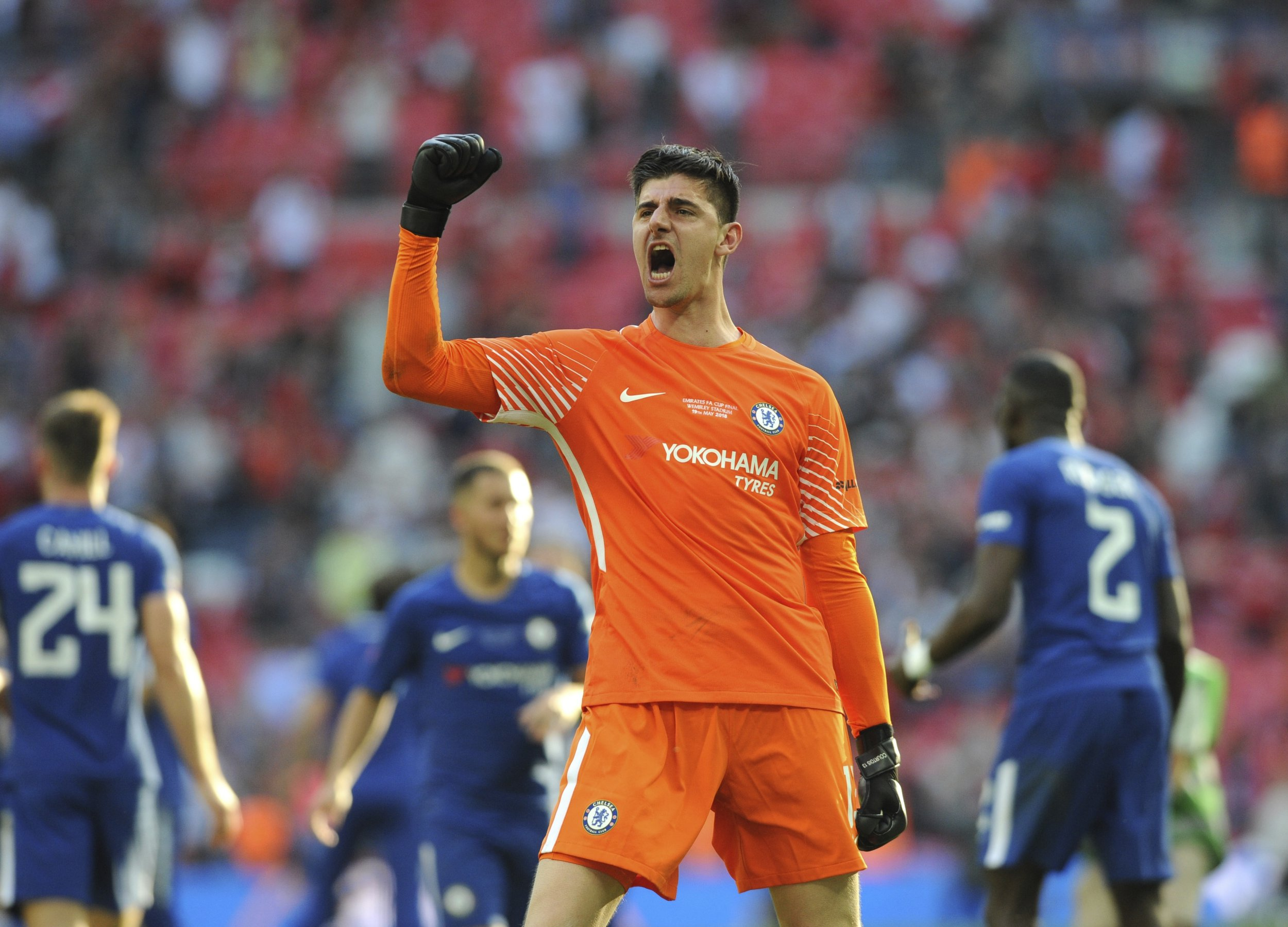 Chelsea's Thibaut Courtois celebrates after winning the English FA Cup final soccer match between Chelsea v Manchester United at Wembley stadium in London, England, Saturday, May 19, 2018. (AP Photo/Rui Vieira)