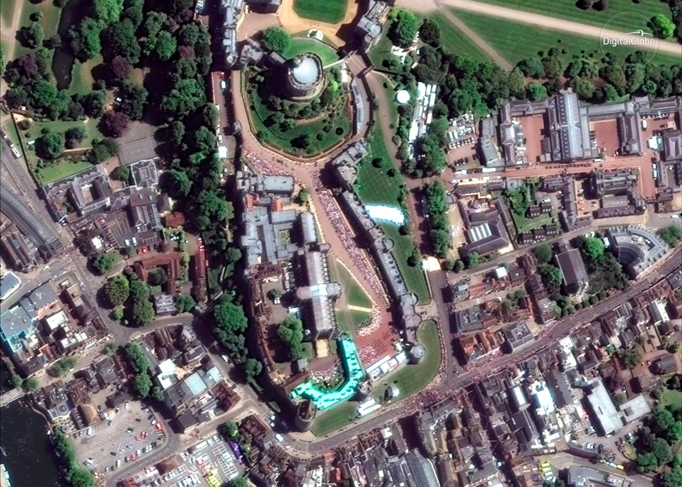 This Saturday, May 19, 2018 satellite image provided by DigitalGlobe shows the royal wedding route close to Windsor Castle in Windsor, near London, England, during the royal wedding of Prince Harry and Meghan Markle. The son of British royalty and the daughter of middle-class Americans wed Saturday in a service that reflected Prince Harry's royal heritage, Meghan Markle's biracial roots and the pair's shared commitment to putting a more diverse, modern face on the monarchy. (Satellite Image ??2018 DigitalGlobe, a Maxar company via AP)