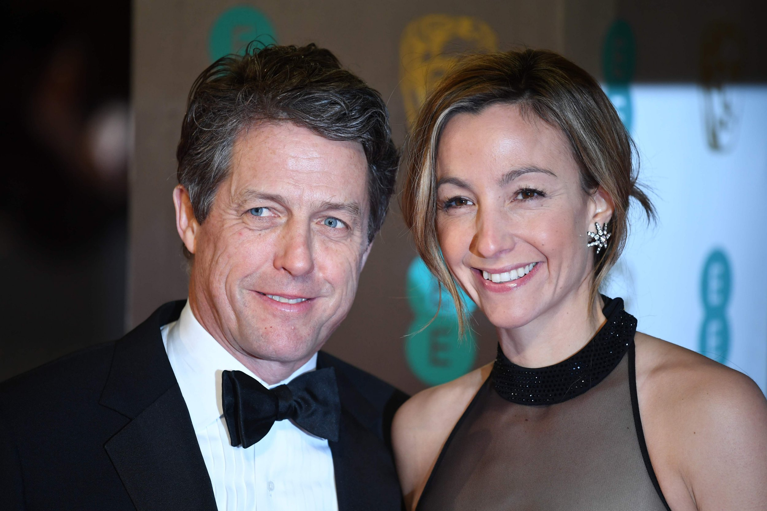 """(FILES) In this file photo taken on February 12, 2017 British actor Hugh Grant (L) and Swedish producer Anna Eberstein (R) pose upon arrival at the BAFTA British Academy Film Awards at the Royal Albert Hall in London on February 12, 2017. Veteran bachelor Hugh Grant, star of a string of romantic comedies including """"Four Weddings and a Funeral"""", is finally getting married for the first time at the age of 57 to his Swedish girlfriend, 39-year-old television producer Anna Eberstein. / AFP PHOTO / Justin TALLISJUSTIN TALLIS/AFP/Getty Images"""