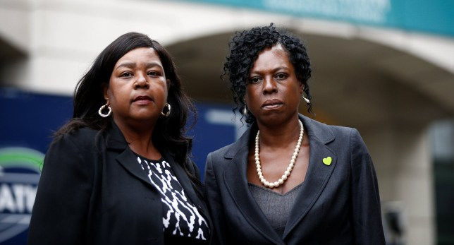 Yvette Williams, representing Justice 4 Grenfell, and Clarrie Mendy-Solomon, who lost two family members in the disaster, pose for photographers outside a commemoration hearing at the opening of the inquiry into the Grenfell Tower disaster, in London, Britain May 21, 2018. REUTERS/Henry Nicholls