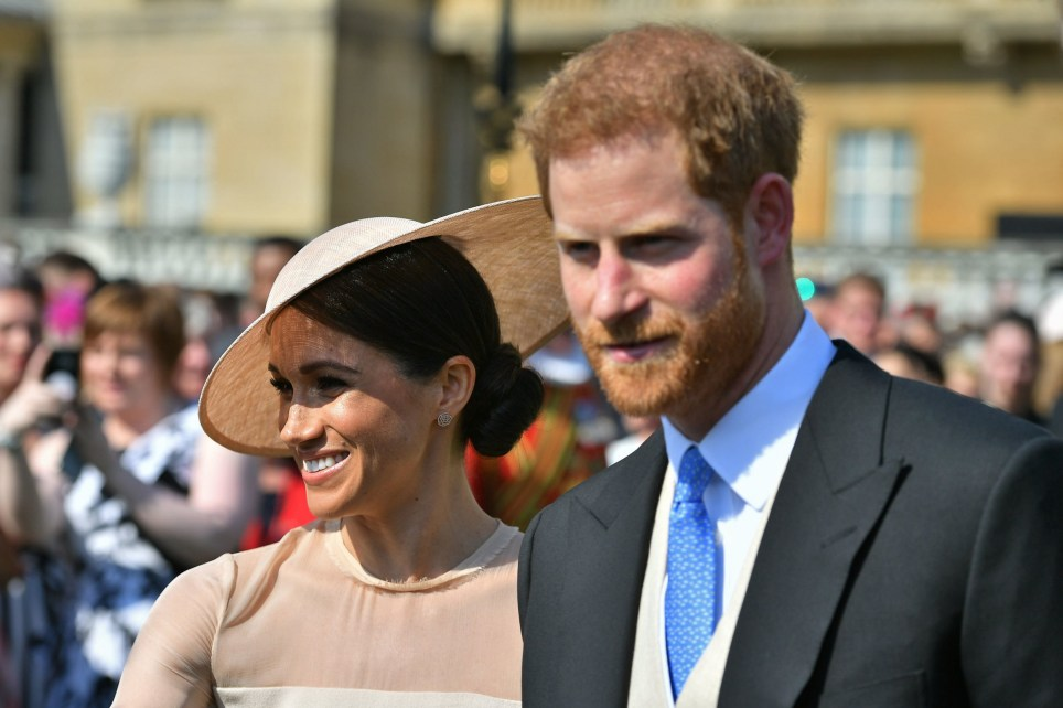 The Duke and Duchess of Sussex at a garden party at Buckingham Palace in London which they are attending as their first royal engagement as a married couple. PRESS ASSOCIATION Photo. Picture date: Tuesday May 22, 2018. The event is part of the celebrations to mark the70th birthday of the Prince of Wales. See PA story ROYAL Sussex. Photo credit should read: Dominic Lipinski/PA Wire