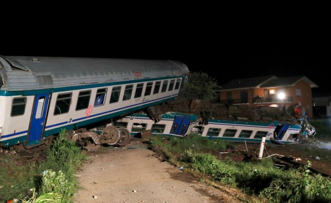 Two dead, 18 injured after train smashes into truck stopped