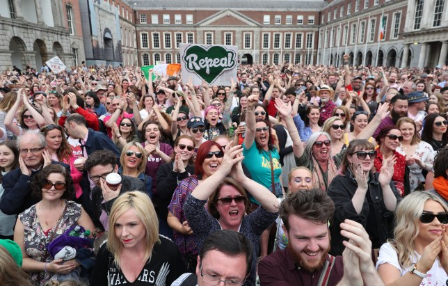 Members of the public celebrate at Dublin Castle after the results of the referendum on the 8th Amendment of the Irish Constitution which prohibits abortions unless a mother's life is in danger. PRESS ASSOCIATION Photo. Picture date: Saturday May 26, 2018. See PA story IRISH Abortion. Photo credit should read: Niall Carson/PA Wire