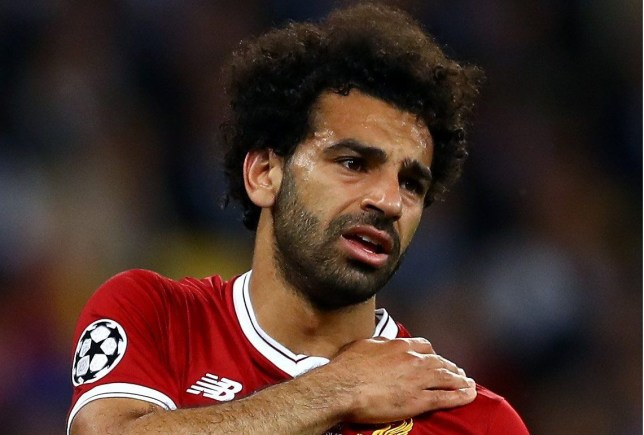 Mandatory Credit: Photo by Kieran McManus/BPI/REX/Shutterstock (9694071di) Mohamed Salah of Liverpool holds his left shoulder shortly before being substituted Real Madrid v Liverpool, UEFA Champions League Final, Olimpiyskiy National Sports Complex Stadium, Kiev, UA, 26 May 2018