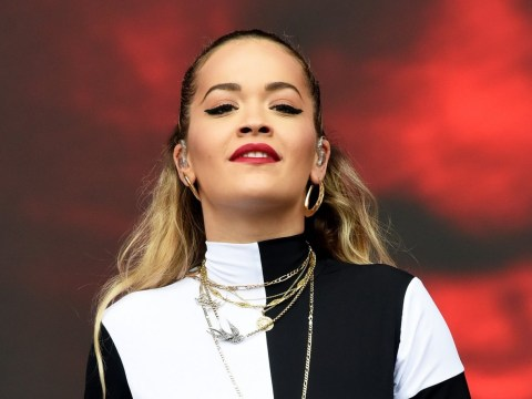 Rita Ora brings the party to Biggest Weekend wearing unitard in local team's colours as she admits singing Avicii song is 'hard'