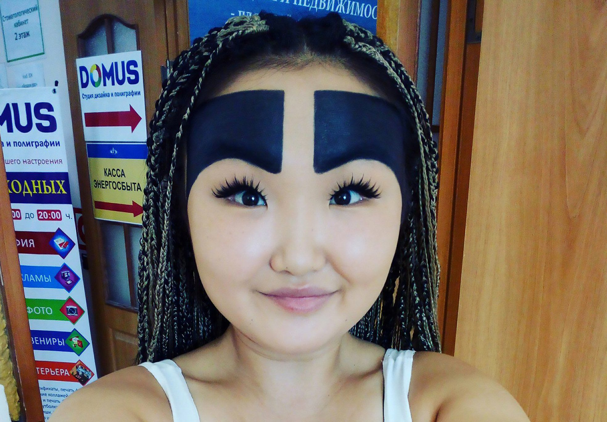 """Pics shows: Anzhelika Protodyakonova; Meet the fashion blogger with humongous painted-on eyebrows that cover most of her forehead. The 21-year-old fashion blogger, Anzhelika Protodyakonova, is from the city of Yakutsk in Russia's south-eastern Sakha Republic. The young woman reached fame accidentally when an onlooker took a photo of her on the bus and shared it online, even though back then Anzhelika says they were no comparison to the whoppers she boasts now. The photo quickly spread over social media and gained her online recognition, with thousands of likes and now over 90,0000 followers on Instagram. According to local media, the young woman wanted to imitate the large eye-brows from the Angry Birds. At first she says she was embarrassed by the photo, but when she saw how much attention she got, she decided to embrace the situation and started painting them bigger and bigger. The blogger says she now lives from advertising and enjoys discounts from many businesses because of her big brows. Social media users have left varying reviews with one user @SadiaSlayy writing: """"Alright babes I???ve been seeing this video going around of super bold brows! Is this going to be the new brow trend of 2017??? Yes or no? Tag a friend who loves bold brows."""" While Netizen ???Gyyyy??? said: """"The moment there is WIFI in any mental asylum, the amount of top bloggers will increase."""""""