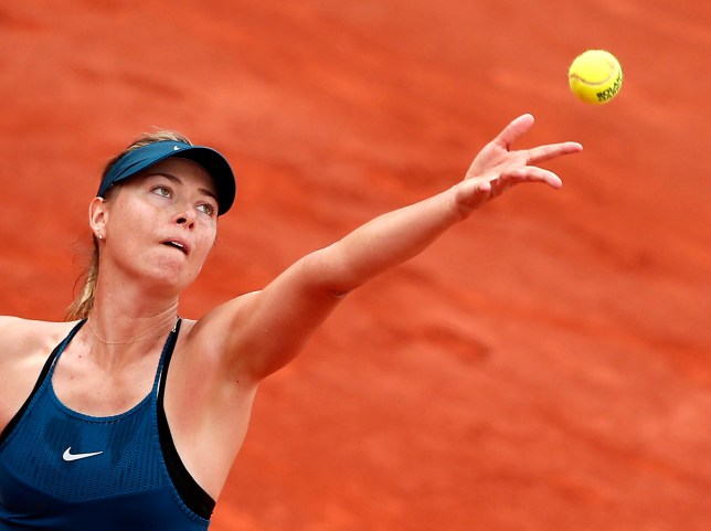 epa06775577 Maria Sharapova of Russia plays Donna Vekic of Croatia during their women???s second round match during the French Open tennis tournament at Roland Garros in Paris, France, 31 May 2018. EPA/IAN LANGSDON
