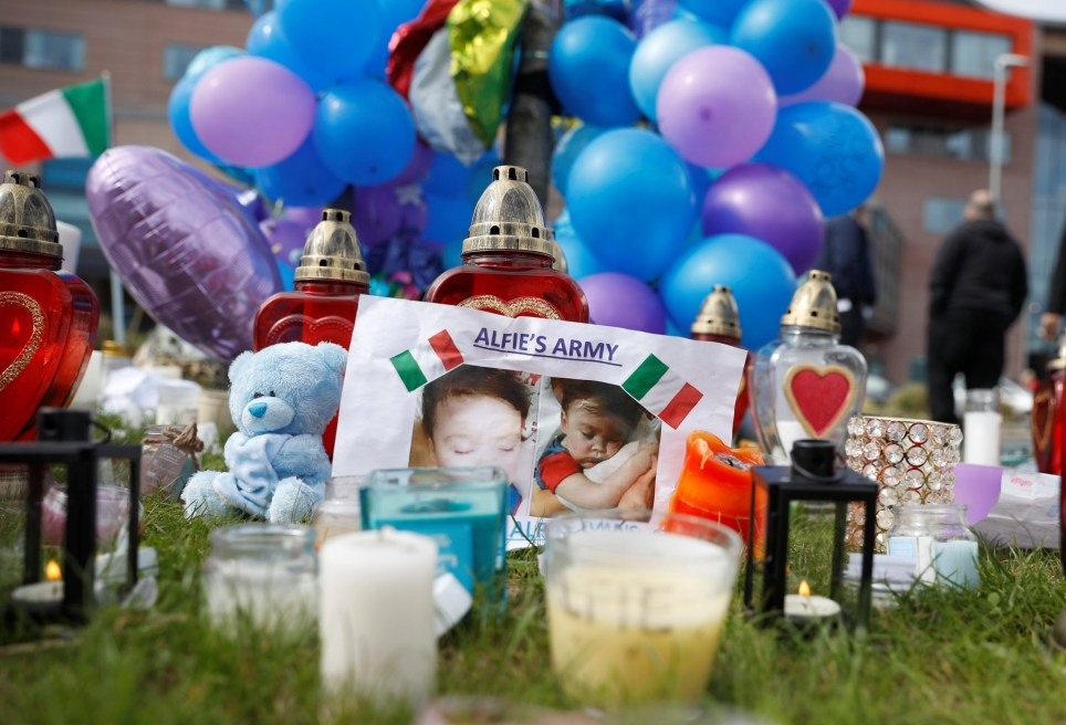 Flowers, candles and childrens' toys left as a memorial to Alfie Evans, the 23-month-old toddler who died a week after his life support was withdrawn, are seen outside Alder Hey Children's Hospital in Liverpool, Britain, April 28, 2018. REUTERS/Phil Noble