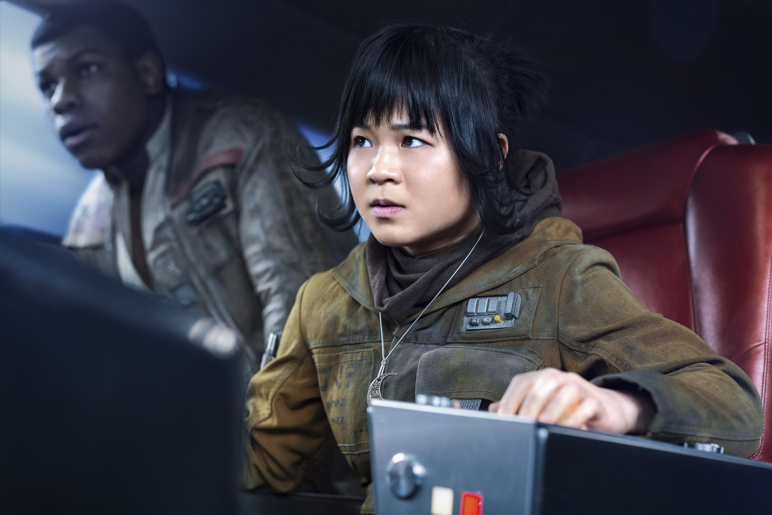 """This image released by Lucasfilm shows Kelly Marie Tran as Rose and John Boyega as Finn, left, in """"Star Wars: The Last Jedi,"""" in theaters on Dec. 15. (Jonathan Olley/Lucasfilm via AP)"""