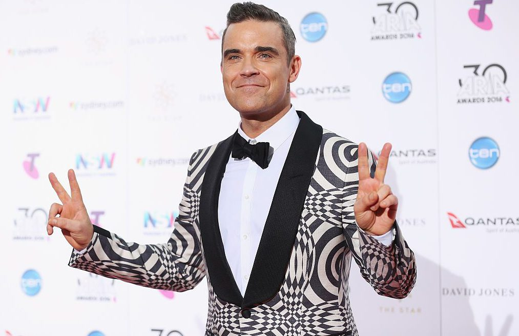 Robbie Williams 'in talks' to be new X Factor judge after Louis Walsh leaves show