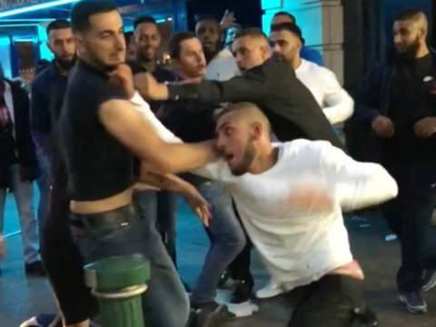 Violent fight breaks out between 11 men and a woman outside a takeaway