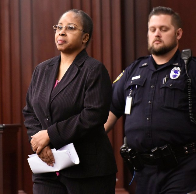 Gloria Williams enters the courtroom for a sentencing hearing ,Thursday, May 3, 2018 at the Duval County Courthouse in Jacksonville, Florida. Williams pleaded guilty in the kidnapping of infant Kamiyah Mobley from University Medical Center in 1998 when Kamiyah was an infant. (Will Dickey/The Florida Times-Union via AP, Pool)