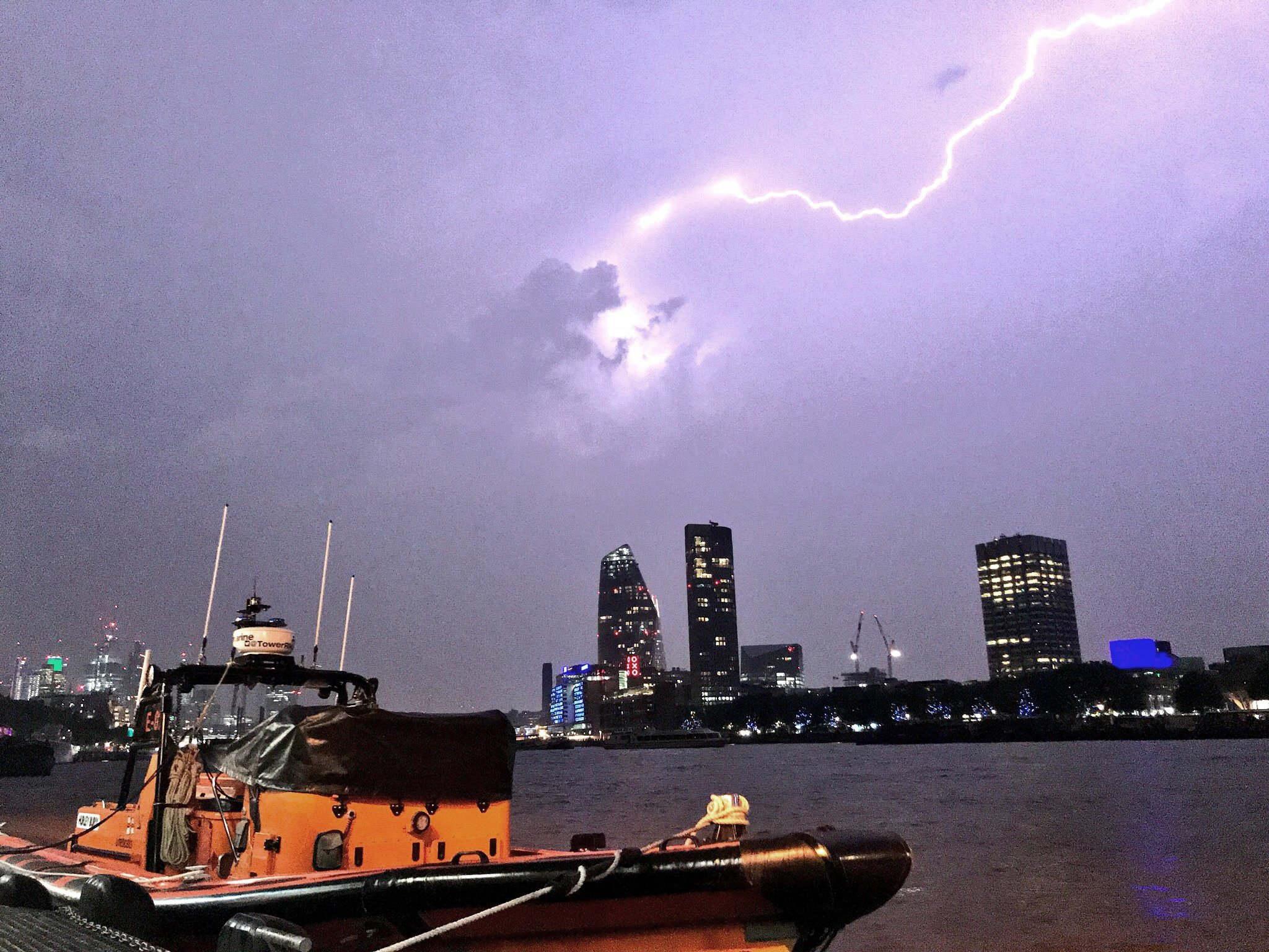 This photo made available by RNLI, shows a lightning strike during a storm in London, Saturday May 27, 2018. British meteorologists say up to 20,000 lightning strikes hit the U.K. during a powerful overnight thunderstorm, and a London-area airport is reporting flight disruptions after an aircraft refueling system was damaged. (Matt Leat/RNLI via AP)