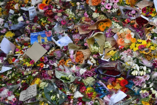 (FILES) In this file photo taken on June 11, 2017 Floral tributes are left on London Bridge in London on June 11, 2017, following the June 3 terror attack that targeted members of the public on London Bridge and Borough Market. Britain marks on June 3, 2018 one year since the bloody terror attack by three men on London Bridge and Borough Market in London that left eight people dead and nearly 50 injured. / AFP PHOTO / Ben STANSALLBEN STANSALL/AFP/Getty Images