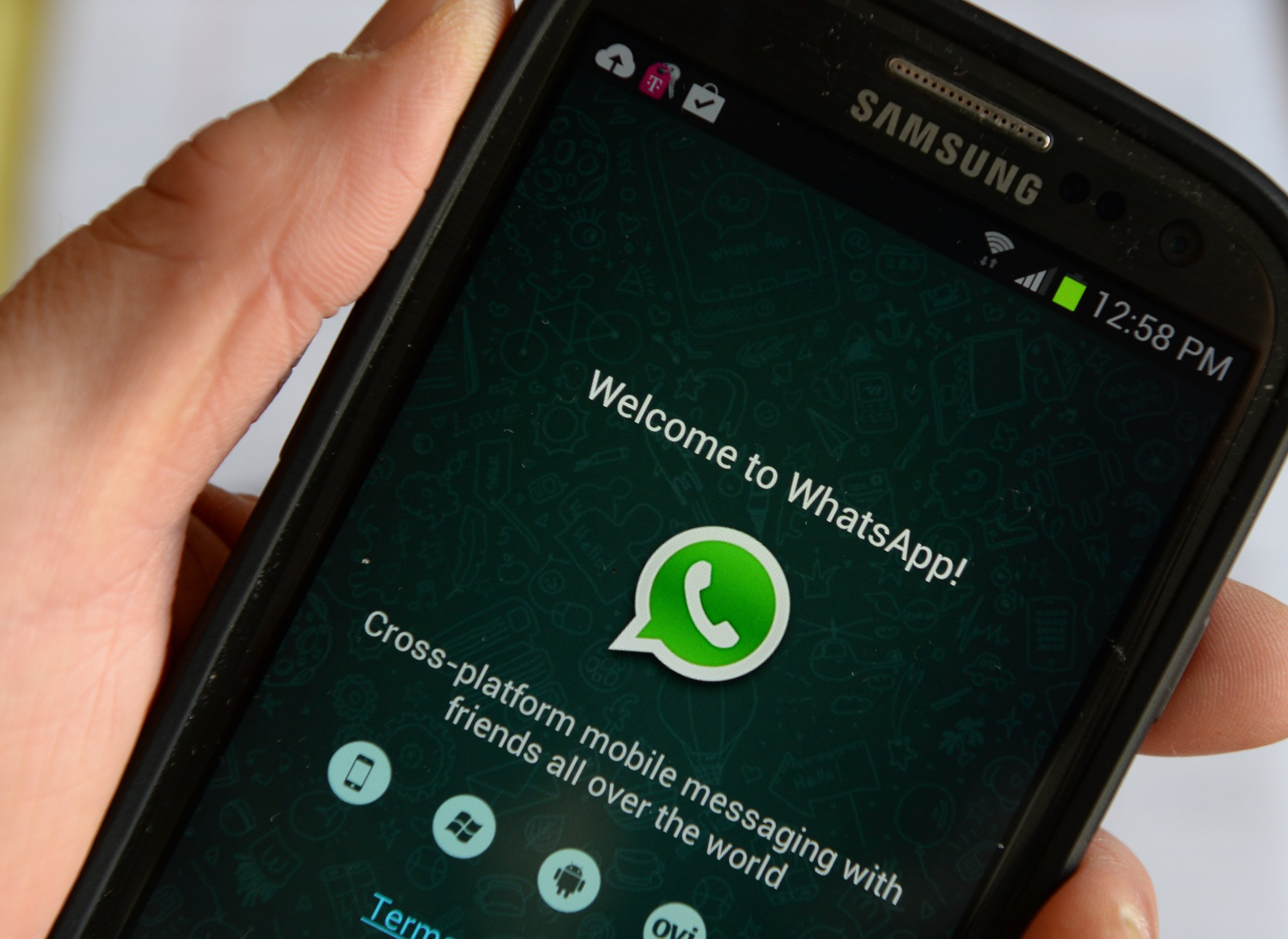 Logo of WhatsApp, the popular messaging service bought by Facebook for USD $19 billion, seen on a smartphone February 20, 2014 in New York. Facebook's deal for the red-hot mobile messaging service WhatsApp is a savvy strategic move for the world's biggest social network, even if the price tag is staggeringly high, analysts say. AFP PHOTO/Stan HONDA / AFP PHOTO / STAN HONDA (Photo credit should read STAN HONDA/AFP/Getty Images)