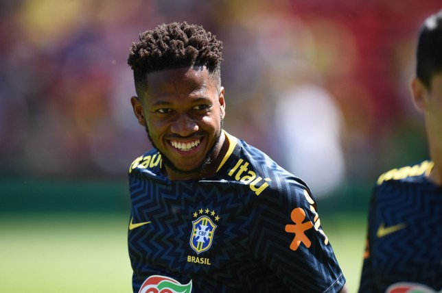 Brazil's midfielder Fred smiles as he warms up ahead of the International friendly football match between Brazil and Croatia at Anfield in Liverpool on June 3, 2018. / AFP PHOTO / Oli SCARFFOLI SCARFF/AFP/Getty Images