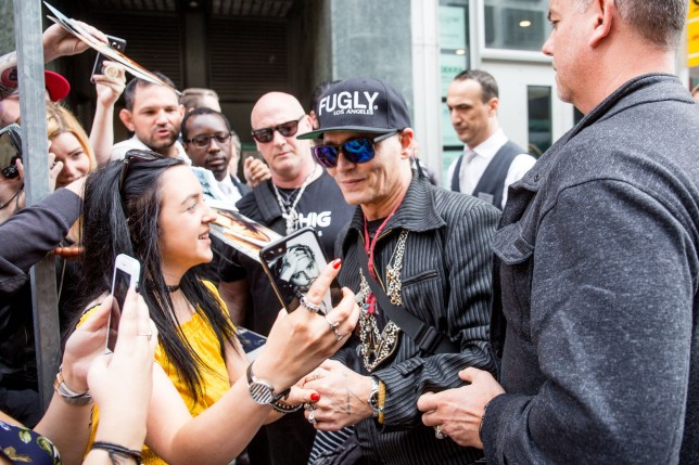 Johnny Depp and Joe Perry are seen arriving at the regent Hotel in Berlin, Germany. Johnny is currently on tour with his rock group Hollywood Vampires. Pictured: Johnny Depp Ref: SPL5000984 030618 NON-EXCLUSIVE Picture by: SplashNews.com Splash News and Pictures Los Angeles: 310-821-2666 New York: 212-619-2666 London: 0207 644 7656 Milan: +39 02 4399 8577 photodesk@splashnews.com World Rights,