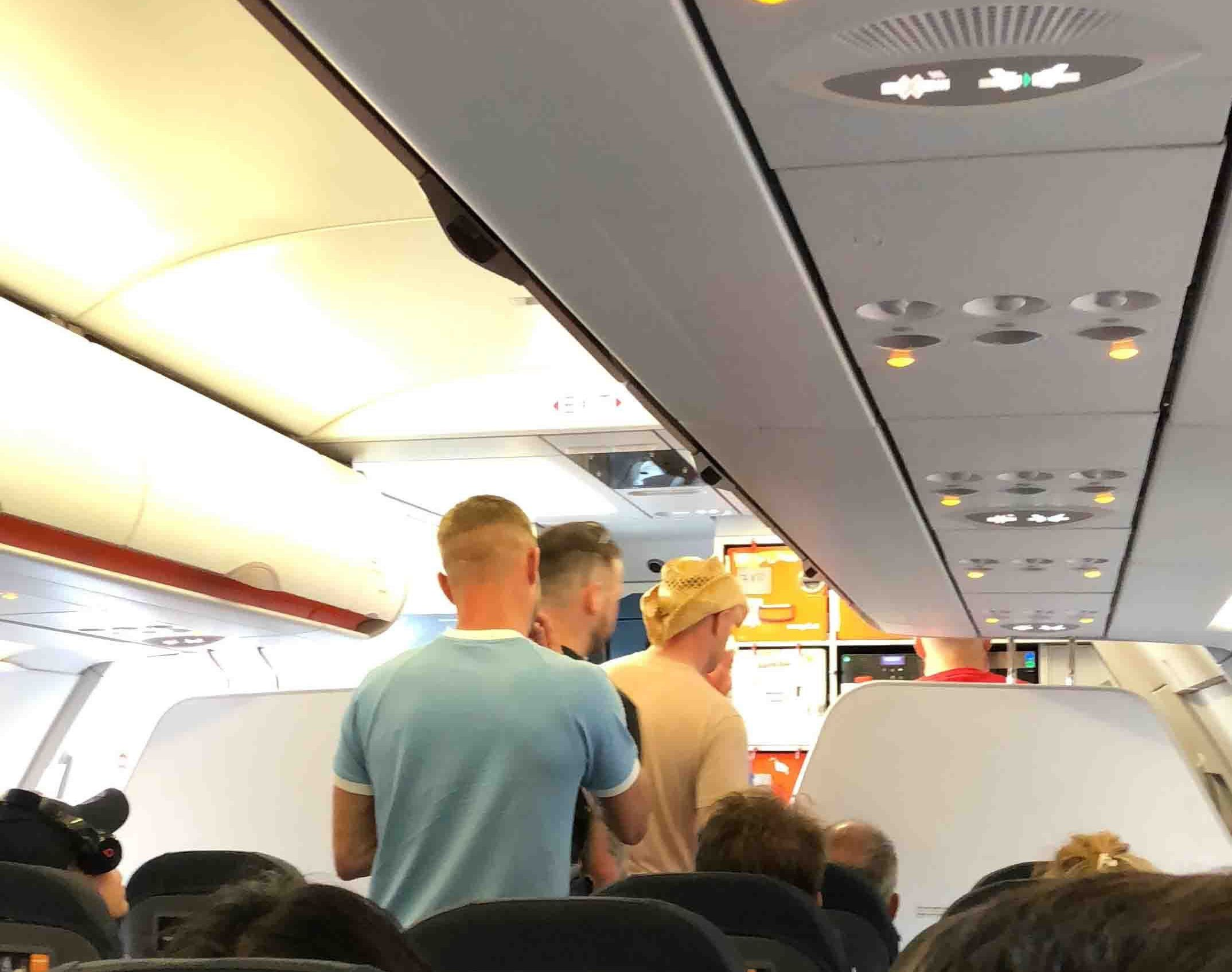 """A passenger on a plane delayed due to the behaviour of a raucous stag do, and later cancelled, has described the ?disgraceful? scenes on-board. On Friday more than 140 people on a flight from Bristol to Prague had their plans ruined as a result of the debacle. A 32-year-old man from the Merthyr Tydfil was arrested on the flight before being released under investigation. Now a passenger has described how the group abused staff on-board and urinated on the floor of the plane before it took off. A passenger has described the circumstances which led to a stag do being removed from a flight from Bristol to Prague. A man from the Merthyr Tydfil area was arrested after the revellers """"treated the plane like a nightclub"""". Pictured: The group being taken from the plane before more than 140 people on the aircraft had to be removed."""