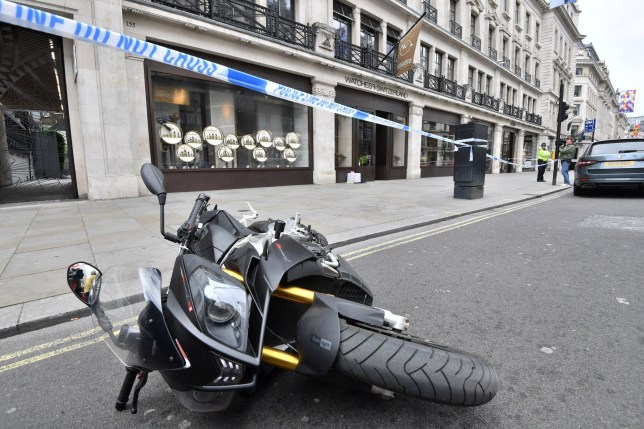 A bike on its side outside Watches of Switzerland on London's Regent Street after raiders on scooters armed with knives and hammers entered the store and stole several items of property. PRESS ASSOCIATION Photo. Picture date: Tuesday June 5, 2018. One person was arrested at the scene on suspicion of robbery. See PA story POLICE Robbery. Photo credit should read: John Stillwell/PA Wire