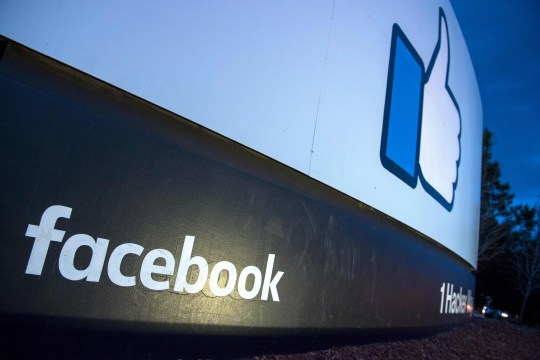 (FILES) In this file photo taken on March 21, 2018, a lit sign is seen at the entrance to Facebook's corporate headquarters in Menlo Park, California. Facebook on June 6, 2018, announced its first original news shows for the social network, joining other online platforms producing video to compete with television. / AFP PHOTO / JOSH EDELSONJOSH EDELSON/AFP/Getty Images