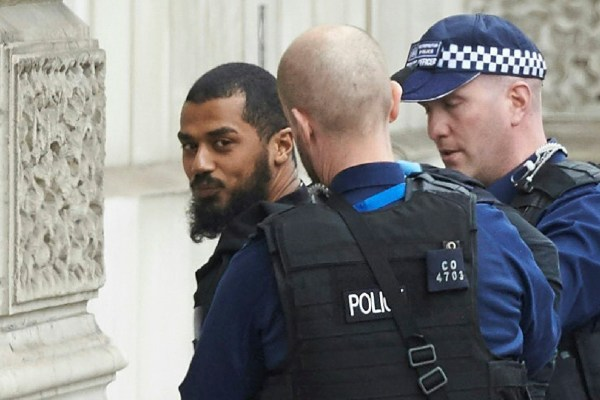 Firearms officiers from the British police detain a man, later named as Khalid Mohammed Omar Ali, on Whitehall near the Houses of Parliament in central London on April 27, 2017 before being taken away by police. Metropolitan police attended an incident on Whitehall in central London near the Houses of Parliament where one man was arrested, police said. Khalid Mohammed Omar Ali, a 27-year-old from north London, is accused of preparing terrorist acts after being arrested not far from Prime Minister Theresa May's Downing Street office on April 27. / AFP PHOTO / Niklas HALLE'N (Photo credit should read NIKLAS HALLE'N/AFP/Getty Images)
