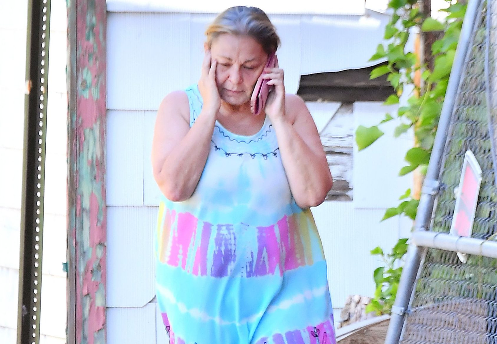 Roseanne Barr spotted looking anguished and crying while talking on the phone in a back alley near her home in Salt Lake City, UT. 07 Jun 2018 Pictured: Roseanne Barr spotted looking anguished and crying while talking on the phone in a back alley near her home in Salt Lake City, UT. Photo credit: Marksman / MEGA TheMegaAgency.com +1 888 505 6342