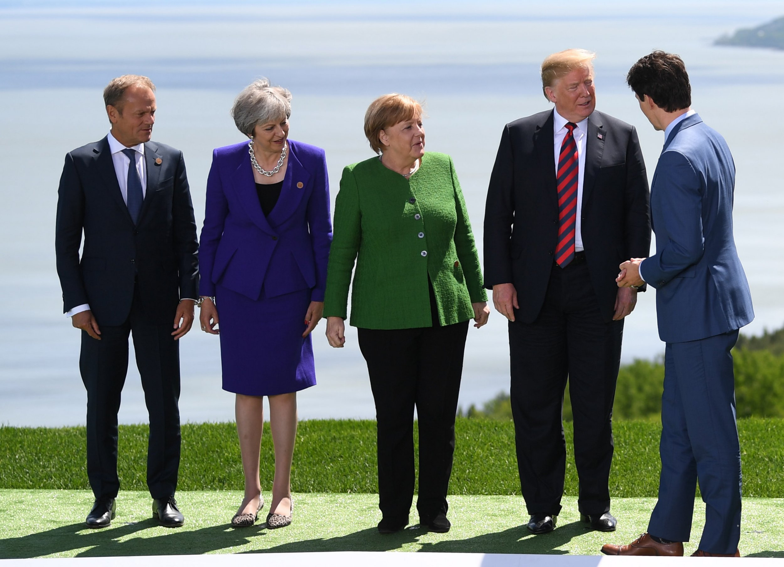 epa06795017 President of the European Council Donald Tusk (L), Britain's Prime Minister Theresa May (2nd L), Germany's Chancellor Angela Merkel (C) and U.S. President Donald Tusk (2nd R) and Canadian Prime Minister Justin Trudeau (R) interact before posing for the Family Portrait at the G7 summit in Charlevoix in Canada 08 June 2018. The G7 Summit runs from 8 to 9 June in Charlevoix, Canada. EPA/NEIL HALL / POOL