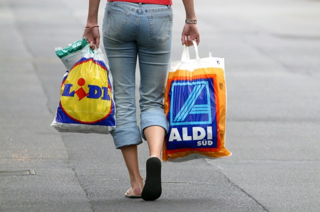 GERMANY - JULY 24: Woman take shopping bags of Lidl and Aldi. (Photo by Ulrich Baumgarten via Getty Images)
