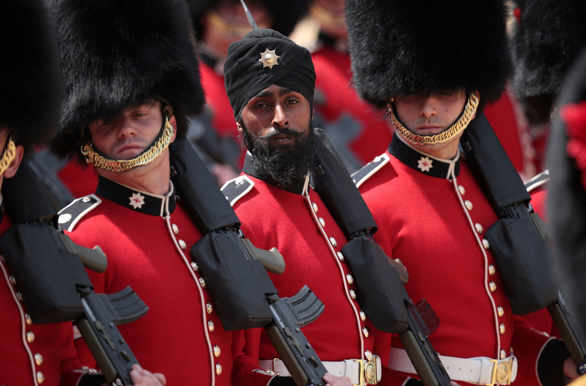LONDON, ENGLAND - JUNE 09: Coldstream Guards soldier Charanpreet Singh Lall the first to wear a turban during the ceremony at The Royal Horseguards during Trooping The Colour ceremony on June 9, 2018 in London, England. The annual ceremony involving over 1400 guardsmen and cavalry, is believed to have first been performed during the reign of King Charles II. The parade marks the official birthday of the Sovereign, even though the Queen's actual birthday is on April 21st. (Photo by Dan Kitwood/Getty Images)
