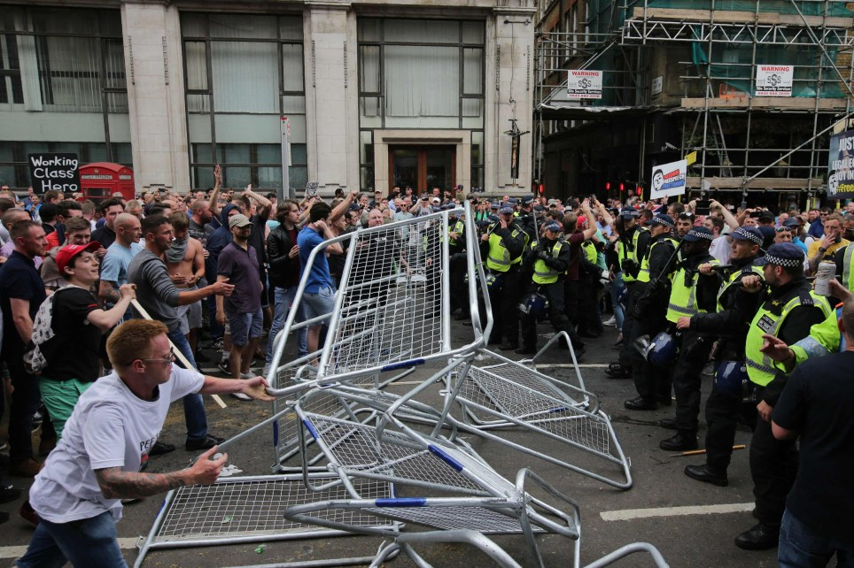 Protesters scuffle with police at the junction of Whitehall and The Mall during a gathering by supporters of far-right spokesman Tommy Robinson in central London on June 9, 2018, following the jailing of Tommy Robinson for contempt of court. / AFP PHOTO / Daniel LEAL-OLIVASDANIEL LEAL-OLIVAS/AFP/Getty Images