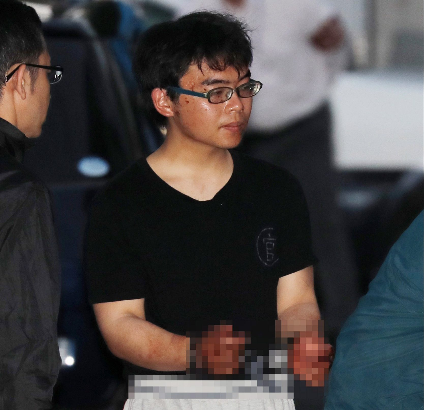 epa06797954 Japanese suspect Ichiro Kojima leaves the Odawara Police Station in Odawara, Japan, 10 June 2018. Kojima allegedly stabbed three people on a bullet train, killing one and injuring two. The 22-year-old man was arrested by police after the bullet train made an emergency stop in Odawara station. EPA/JIJI PRESS JAPAN OUT / IMAGE PIXIELATED AT SOURCE EDITORIAL USE ONLY/NO SALES/NO ARCHIVES