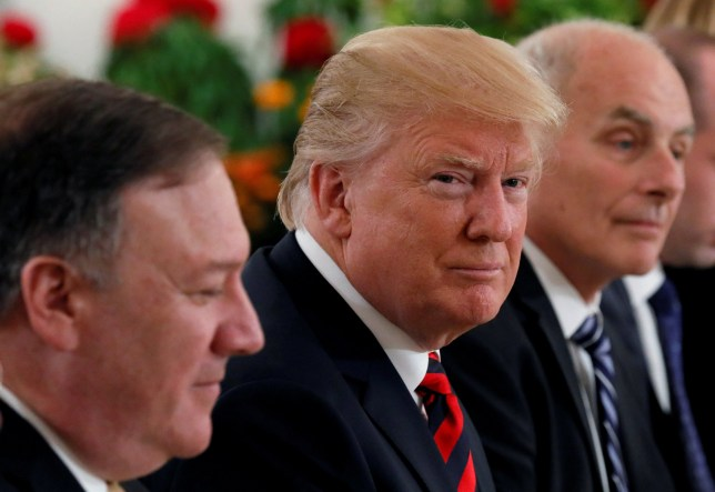 U.S. President Donald Trump flanked by Secretary of State Mike Pompeo and White House Chief of Staff John Kelly attend a lunch with Singapore's Prime Minister Lee Hsien Loong and officials at the Istana in Singapore June 11, 2018. REUTERS/Jonathan Ernst TPX IMAGES OF THE DAY