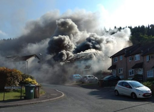 Five people have been rushed to hospital after an explosion at a house in Llanbradach near Caerphilly in South Wales. Pictured here is the scene just after the explosion WALES NEWS SERVICE