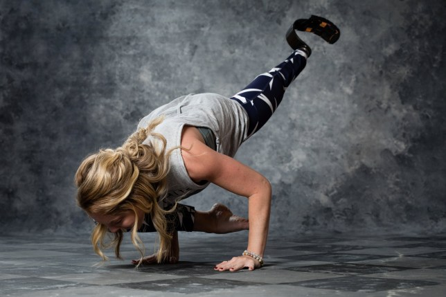 """Super fit Kelsey Koch. See SWNS story NYYOGI; An amputee quit her boring billing job to open her own yoga studio to help other people living without limbs. Kelsey Koch, 25, was born without a left tibia and her parents Barb, 57, and Jeff Koch, 59, made the difficult decision to have her leg amputated through the knee when she was nine months old. Growing up, Kelsey loved golf but her heavy prosthetic leg prevented her from running or taking part in other sports. When Kelsey began to work with personal trainer Jen Colombo to treat her scoliosis in 2016, the fitness expert encouraged her to research prosthetics to help optimize her exercise. Kelsey, of Grand Blanc, Michigan, was fitted for a lightweight running blade prosthetic and began to thrive in Jen???s advanced yoga classes at Genesys Athletic Club. At the time, Kelsey was not content in her job in the billing department of a local company and decided to abandon her career to become a yoga teacher. Kelsey said: ???I???ve had a prosthetic limb ever since I was a baby. ???I learned to walk with one so I have never had the feeling that I ever lost something because I don???t remember. """"I have never known anything different."""