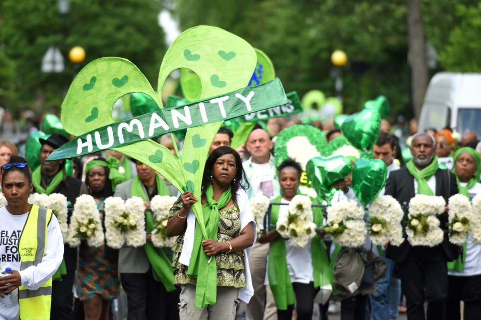 A procession following the Grenfell Tower fire Memorial Service, at St Helen's Church, North Kensington, to mark one year since the blaze, which claimed 72 lives. PRESS ASSOCIATION Photo. Picture date: Thursday June 14, 2018. Thursday marks 12 months since a small kitchen fire in the high-rise turned into the most deadly domestic blaze since the Second World War. See PA story MEMORIAL Grenfell. Photo credit should read: David Mirzoeff/PA Wire