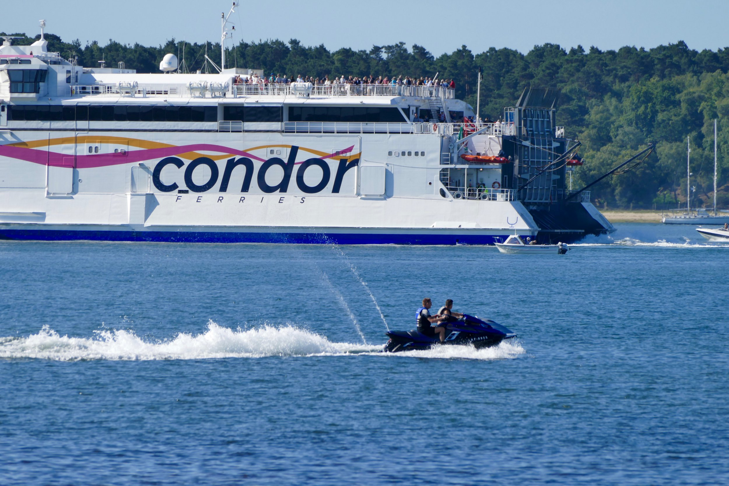 Mandatory Credit: Photo by Geoffrey Swaine/REX/Shutterstock (8871082j) Jet skiers pass the outbound Condor Ferry at Brownsea Island on a hot morning in Dorset Seasonal weather, Hampshire, UK - 17 Jun 2017