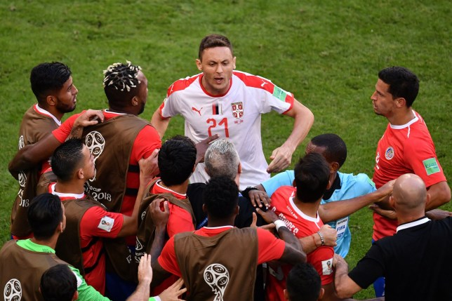 Serbia's midfielder Nemanja Matic (C) is held back by Costa Rica players following an altercation with one of their coaches during the Russia 2018 World Cup Group E football match between Costa Rica and Serbia at the Samara Arena in Samara on June 17, 2018. / AFP PHOTO / Fabrice COFFRINI / RESTRICTED TO EDITORIAL USE - NO MOBILE PUSH ALERTS/DOWNLOADSFABRICE COFFRINI/AFP/Getty Images
